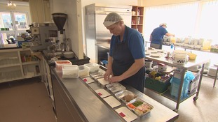 Meals on Wheels staff preparing food for the elderly