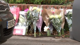 Tributes outside the house after her death.