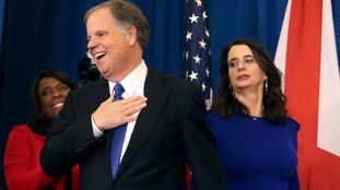 Democrat Doug Jones claims shock victory in Alabama Senate race against Republican Roy Moore