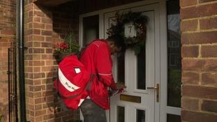 Postman delivering Christmas cards.