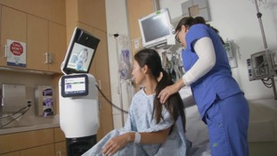 A doctor using the iRobot's RP-VITA system to consult with a patient