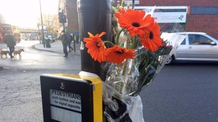 Flowers have been left at the scene.