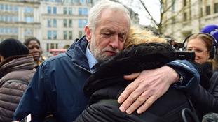 Jeremy Corbyn hugs a woman after the service.