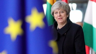 May insists Brexit 'on course' despite Commons defeat