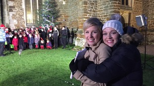 Becky and weather presenter Aisling Creevey huddle for warmth.