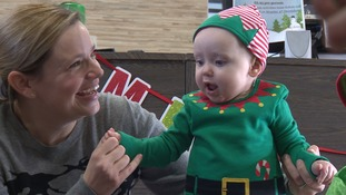 The babies have been dressed as elves for their Christmas visits!