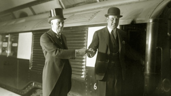 Lord Ashfield hands over a train key at the opening of the Northern line in 1926