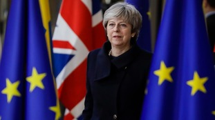 The prime minister believes she is 'on course to deliver Brexit'.