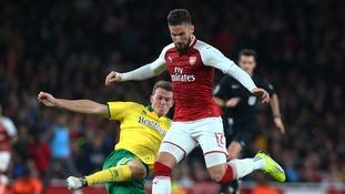 Zimmermann challenges Arsenal striker Olivier Giroud in the League Cup.