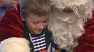 Ben Gutierrez, here with Santa Claus, had been waiting for his operation.