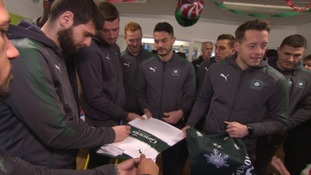 The squad make it a point to try to visit kids in hospital annually.