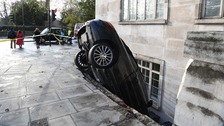 Driver arrested after Mercedes parked vertically