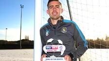 Luton Town midfielder Olly Lee shows off his award for the EFL League Two Goal of the Month for November