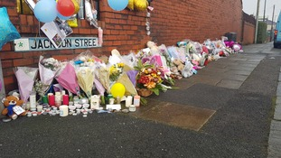 The growing memorial at the scene