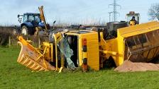 Gritter truck overturned in field in Antrim