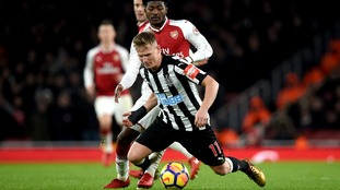 Arsenal's Ainsley Maitland-Niles (back) and Newcastle United's Matt Ritchie battle for the ball during the Premier League match at the Emirates Stadium.