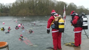140 people dressed as Santa braved freezing temperatures for a mass scuba dive.