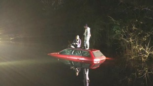 Rescue teams arrived at the scene to find the two men standing on top of their car roof.