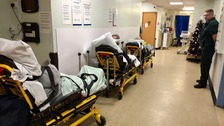Patients queue on trolleys in hospital corridors