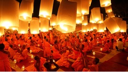 Buddhist monks launch paper lanterns into the sky to pay homage to Lord Buddha