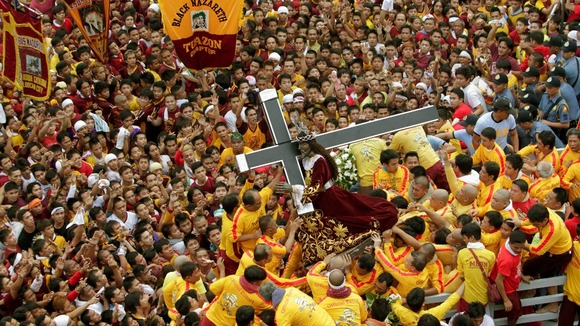 Devotees carry the statue of the Black Nazarene