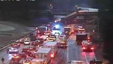 Train derails off bridge on to busy road near Seattle