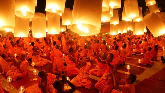 Buddhist monks launch paper lanterns into the sky