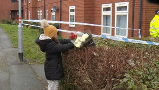 Flowers being laid outside at house in Northampton following the death of a two-year-old boy.