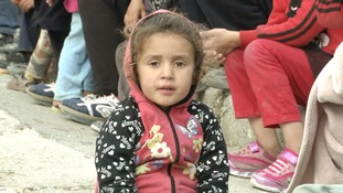 The children are among thousands housed on the Aegean islands.