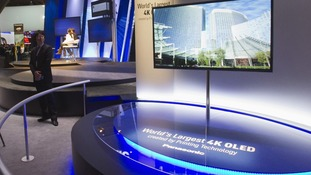 A 56-inch, 4K OLED television set is displayed at the Panasonic booth during the first day of the CES in Las Vegas