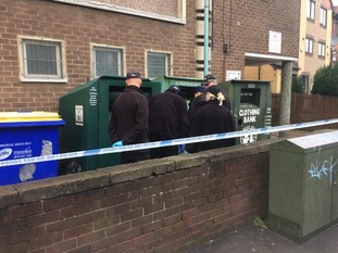 Police searching bins outside the centre