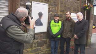 Frank Ritchie (left), MSP Oliver Mundell (middle) Mark Smith, Alive Radio (right) pictured next to the poster Frank campaigned for