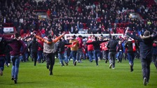 Bristol City fans invade the pitch after the final whistle marking the club's victory over Man United in the quarter finals.