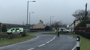 The village is cordoned off while police follow a 'positive line of inquiry'