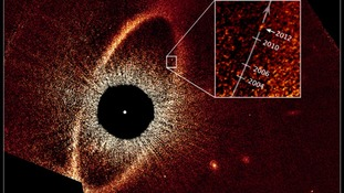 This false-colour composite image, taken with the Hubble Space Telescope, reveals the orbital motion of the planet Fomalhaut b