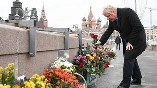 Mr Johnson laid flowers at the spot where Boris Nemtsov was assassinated