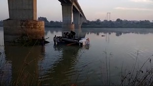 33 dead as bus plunges off bridge into river in India