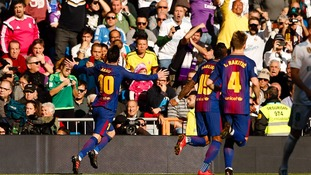 Barcelona all but ended 10-man Real Madrid's faint title ambitions with a 3-0 mauling at the Bernabeu in El Clasico