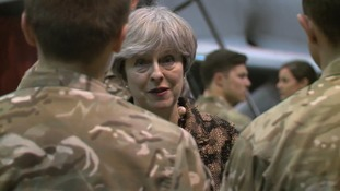 May pays tribute to 'valiant' service personnel in Christmas message to troops