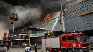 Dozens feared dead in Philippines shopping centre fire