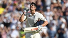 Alastair Cook celebrates his century in Melbourne.