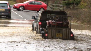 Floodwater blocked a road in Scarning near Dereham.