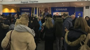 Large crowds gathered at baggage enquiries.