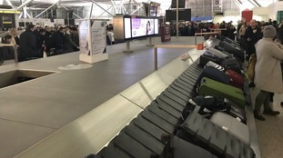 Passengers faced large delays in retrieving their luggage after flights were grounded.