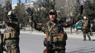 Security forces respond to the attack on the cultural centre.
