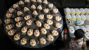 Carnival masks bearing the likeness of Brazilian soccer player Neymar, are pictured on a factory assembly line