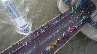 Runners in the London Marathon over Tower Bridge