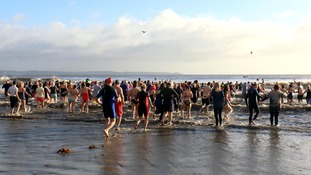 250 swimmers joined the volunteer crew at Looe RNLI for the 6th annual Looe New Year's Day dip.