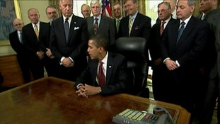 President Obama prepares to sign an executive order to close Guantanamo Bay in 2009