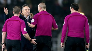 Swansea City manager Carlos Carvalhal (second left) speaks with match referee Robert Madley (second right) after the final whistle.